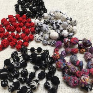 Exclusive exhibition Hand made embroidered beads made from a mixture of natural fibres